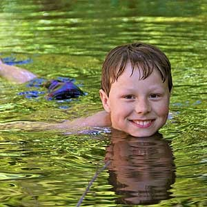 Laine Otto, 9, is stoked to be swimming in water that isn't a pool. Photo by Chip Scheuer.
