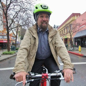 Santa Cruz Councilmember Micah Posner believes the city's bike distribution should go back to a nonprofit like the Bike Church, rather than to auction. Photo by Chip Scheuer