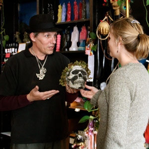 Sacred Grove owner Birch helps a customer at his Soquel Avenue shop. Photo by Chip Scheuer.