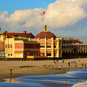 The flag at the Boardwalk flies at half-mast after last week's shootings in Santa Cruz. Photo by Chip Scheuer.