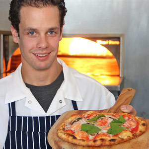 West End Tap & Kitchen co-owner and chef Geoff Hargrove with one of his flatbread pizzas.