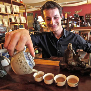 Noah Kopito pours tea at Hidden Peak. Owner David Wright believes in creating a tea experience that's accessible to everyone.