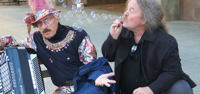 Frank Lima, a.k.a. the Great Morgani (left), gets some soothing bubble magic from another Pacific Avenue street-performance legend, Tom Noddy. Photo by Chip Scheuer.