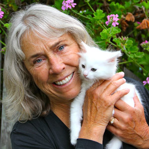 Lynne Achterberg, the founder of Project Purr, with Fluff, a feral cat she rescued from the Santa Cruz County shelter. Photo by Chip Scheuer.