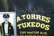A Torres Tuxedo logo