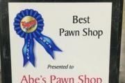Abe's Pawn Shop logo