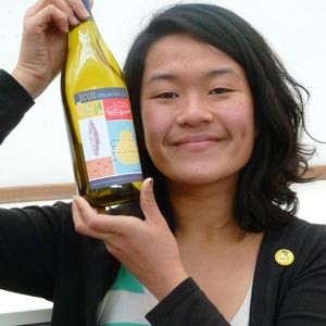 Louise Leong with Banana Slug Roussane and her new original design. Photo by Christina Waters.