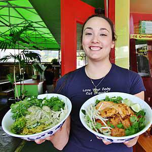 Candy Eleazarraraz serves up tasty Asian street food at Charlie Hong Kong. Chip Scheuer photo.