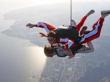 Tandem skydiving instructor Kevin Kramer and Santa Cruz Weekly staff writer Curtis Cartier in freefall over Monterey Bay