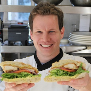 Booka's Chef Eli Epstein with a schnitzel-style catering creation from the menu of his new 831 Sandwiches.